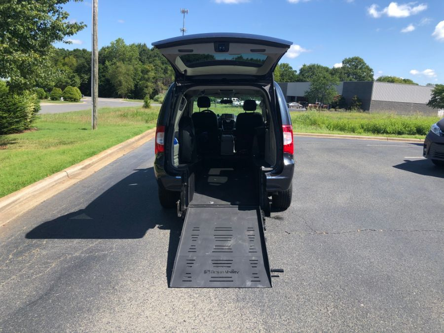 Silver Chrysler Town and Country with Rear Entry Manual Fold Out ramp