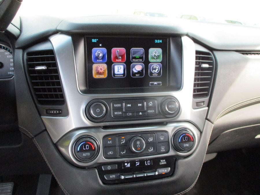 Gray Chevrolet Suburban image number 13