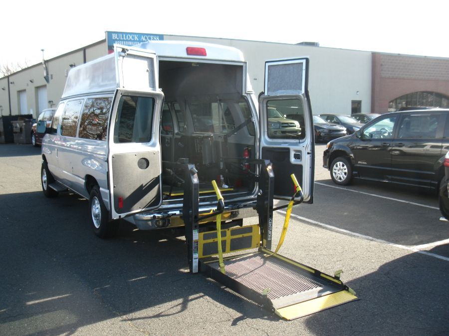 Silver Ford E-Series Wagon with Rear Entry Automatic Fold Out ramp