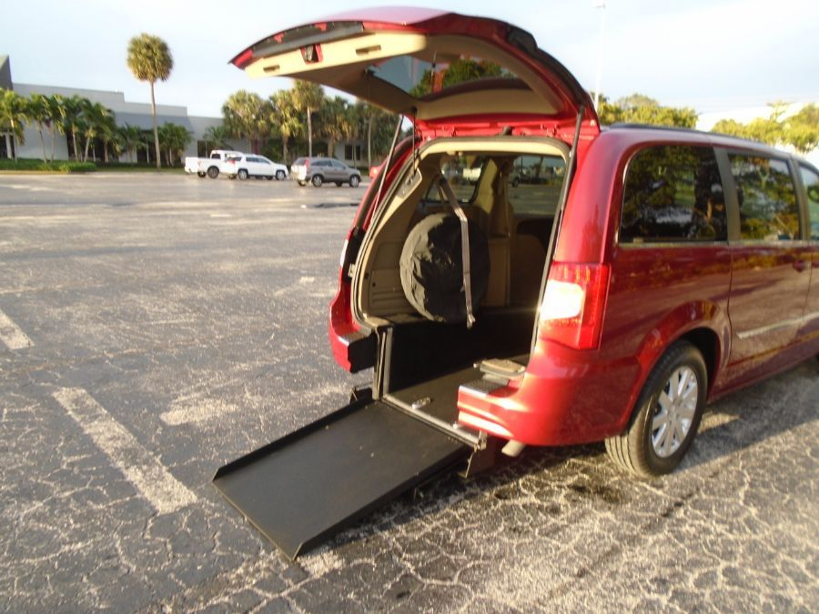 Red Chrysler Town and Country with Rear Entry Automatic Fold Out ramp