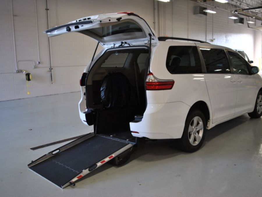 White Toyota Sienna with Rear Entry Manual Fold Out ramp