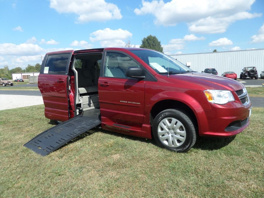 Red Dodge Grand Caravan with Side Entry Manual Fold Out ramp