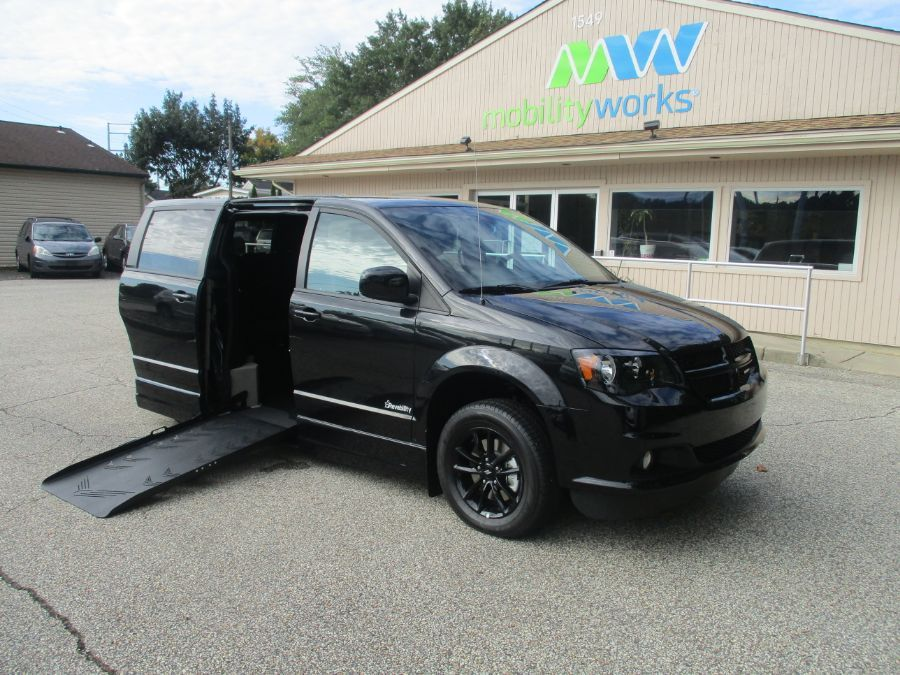 Black Dodge Grand Caravan with Side Entry Automatic Fold Out ramp
