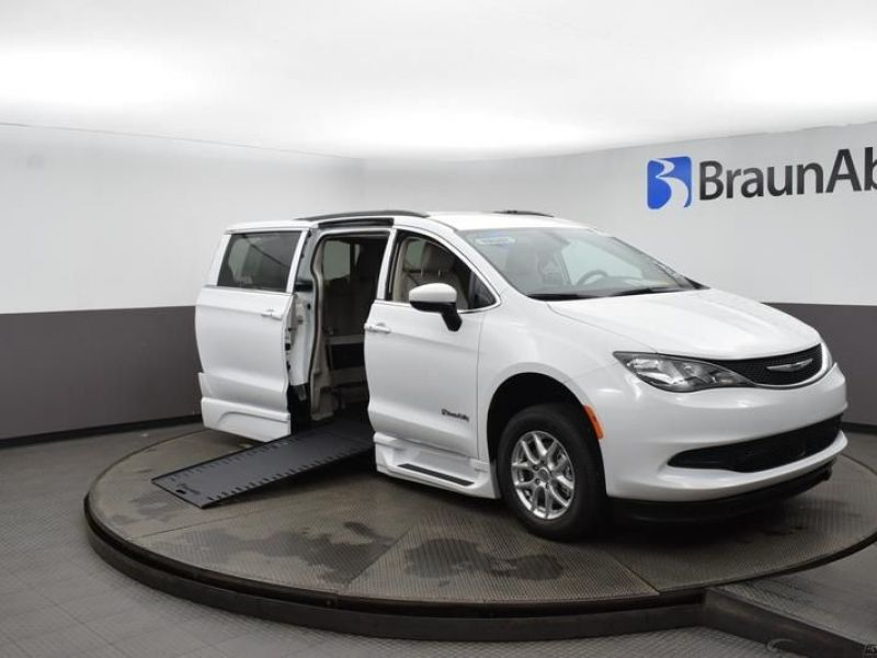 White Chrysler Voyager with Side Entry Automatic In Floor ramp