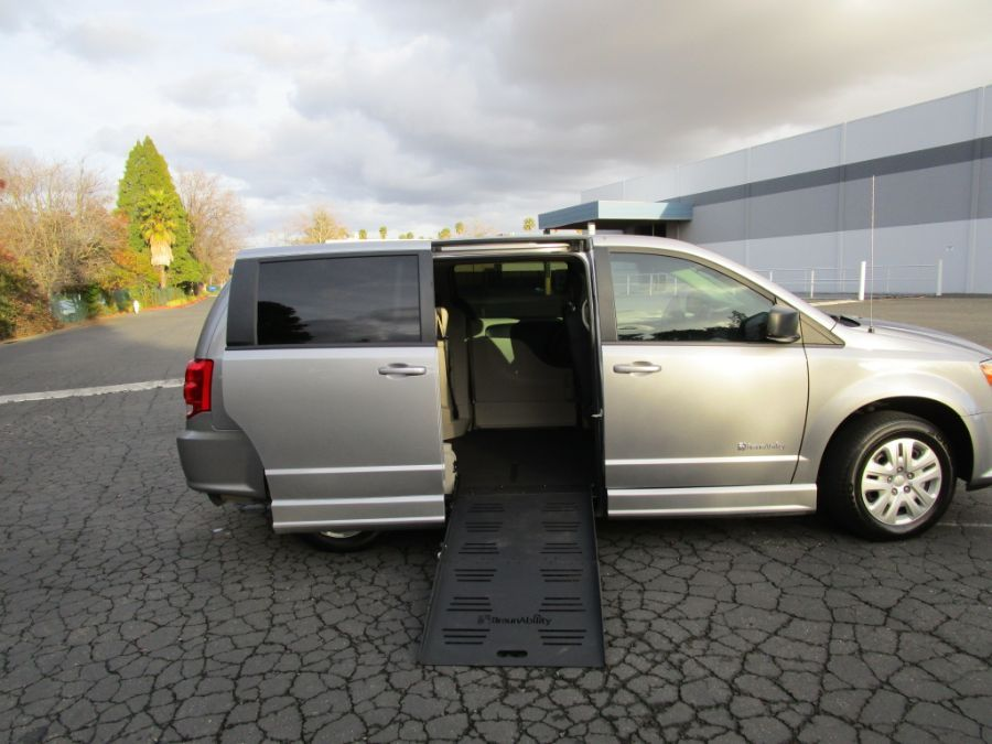 Silver Dodge Grand Caravan with Side Entry Manual Fold Out ramp