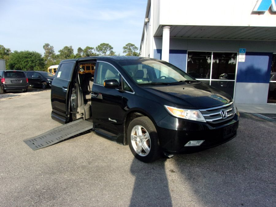 Black Honda Odyssey with Side Entry Automatic Fold Out ramp