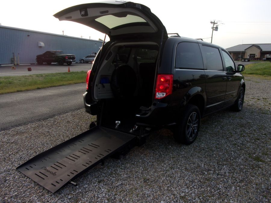 Black Dodge Grand Caravan with Rear Entry Manual  ramp