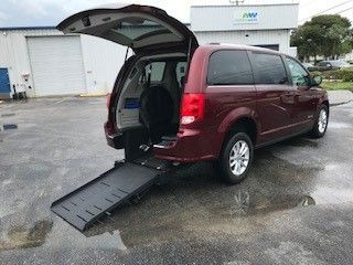 Red Dodge Grand Caravan with Rear Entry Automatic Fold Out ramp