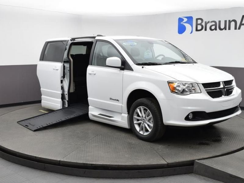 White Dodge Grand Caravan with Side Entry Automatic In Floor ramp