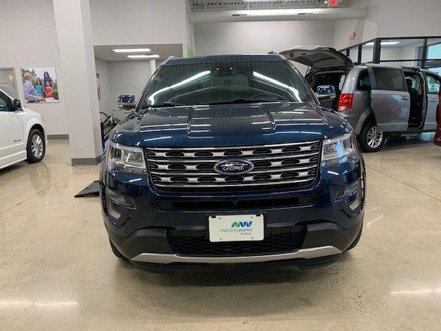 Blue Ford Explorer image number 1