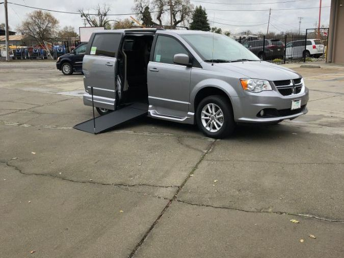 Silver Dodge Grand Caravan with Side Entry Manual In Floor ramp
