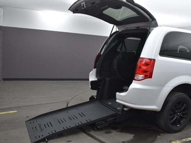 White Dodge Grand Caravan with Rear Entry Manual Fold Out ramp