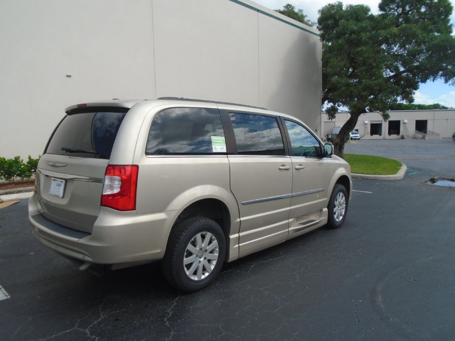 Gold Chrysler Town and Country image number 6