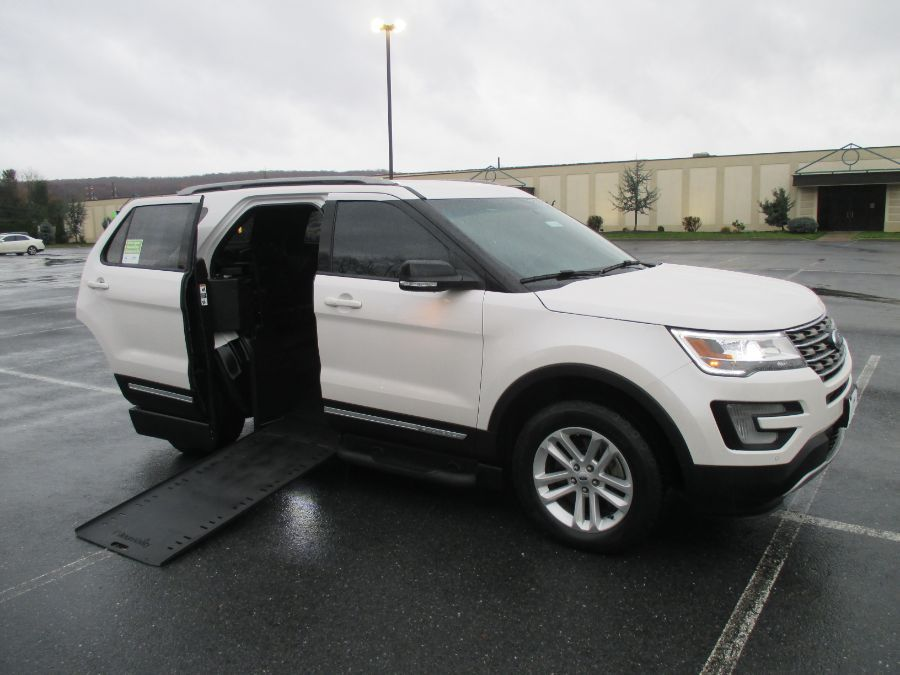 White Ford Explorer with Side Entry Automatic In Floor ramp