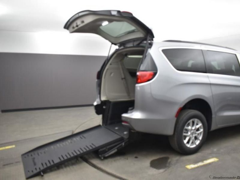 Silver Chrysler Voyager with Rear Entry Manual Fold Out ramp