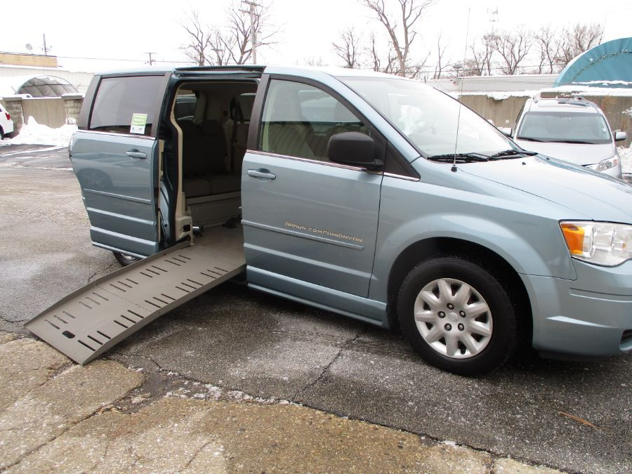 Blue Chrysler Town and Country with Side Entry Manual Fold Out ramp