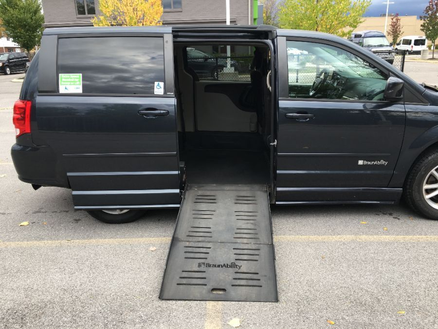 Blue Dodge Grand Caravan with Side Entry Manual Fold Out ramp