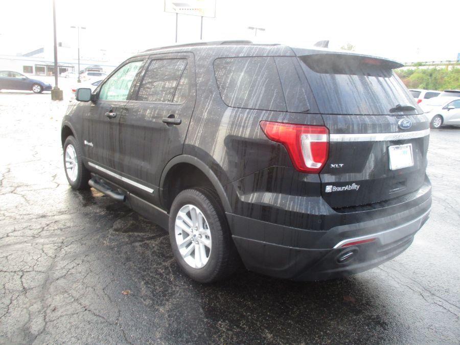Black Ford Explorer image number 4