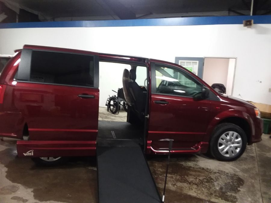 Red Dodge Grand Caravan with Side Entry Manual In Floor ramp