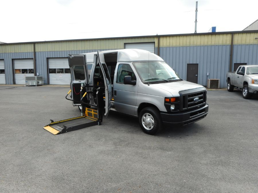 Silver Ford E-150 with Side Entry   ramp