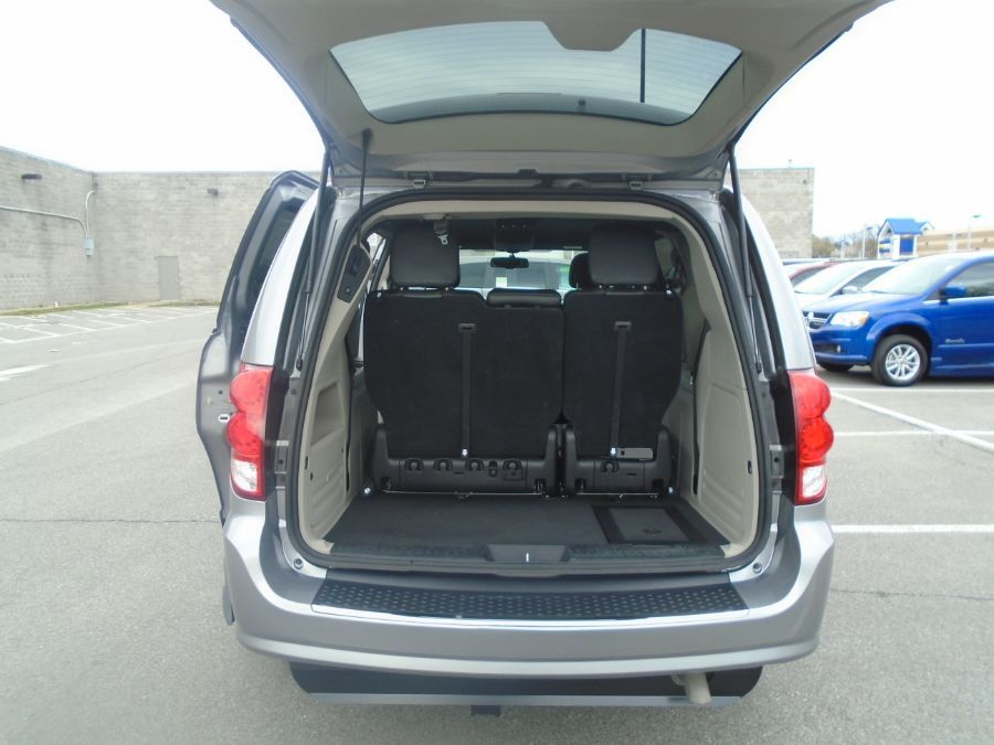 Silver Dodge Grand Caravan with Side Entry Automatic In Floor ramp