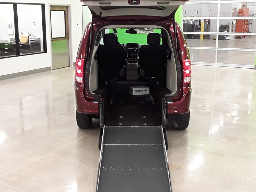 Red Dodge Grand Caravan with Rear Entry Manual Fold Out ramp