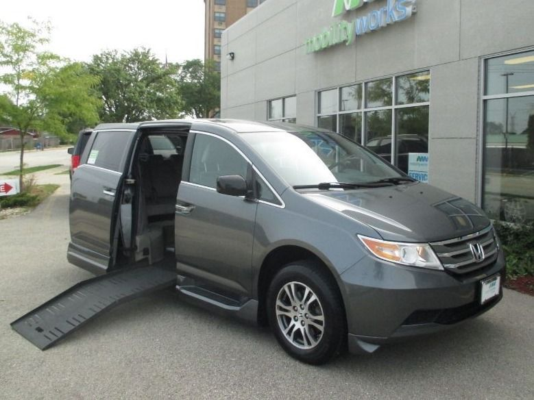 Silver Honda Odyssey with Side Entry Automatic Fold Out ramp