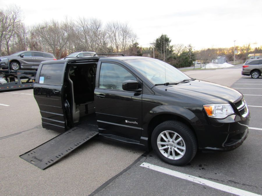 Black Dodge Grand Caravan with Side Entry Automatic In Floor ramp