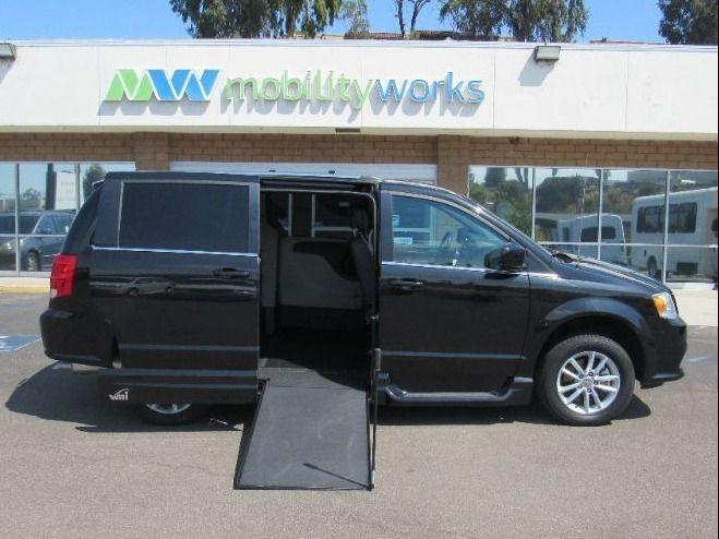 Black Dodge Grand Caravan with Side Entry Manual In Floor ramp
