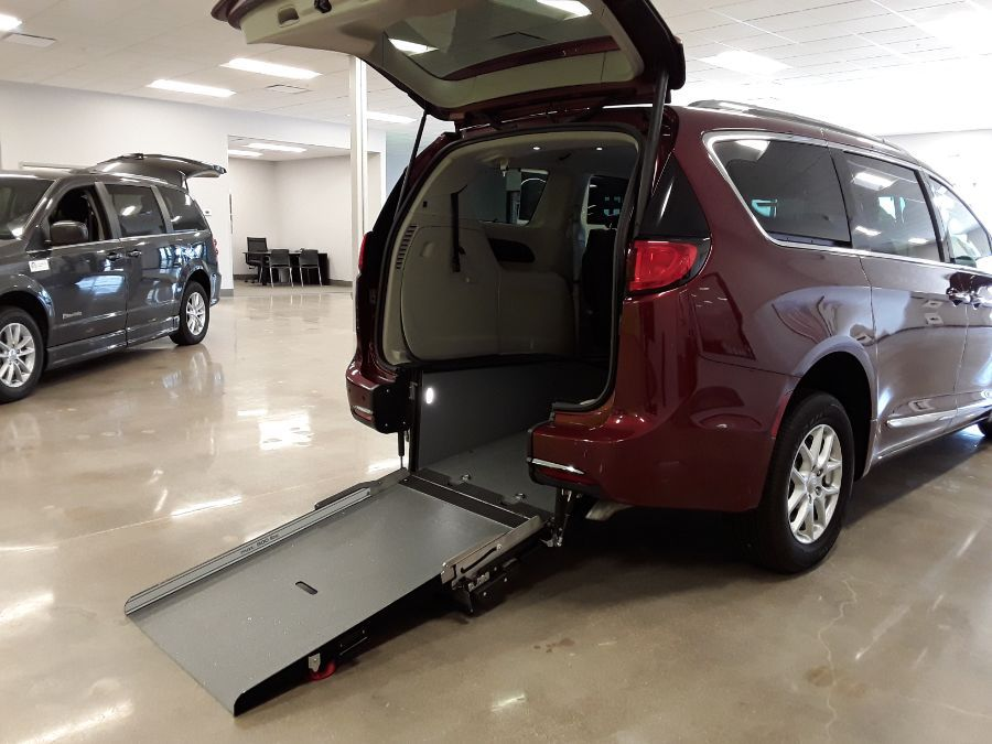 Red Chrysler Pacifica with Rear Entry Manual Fold Out ramp