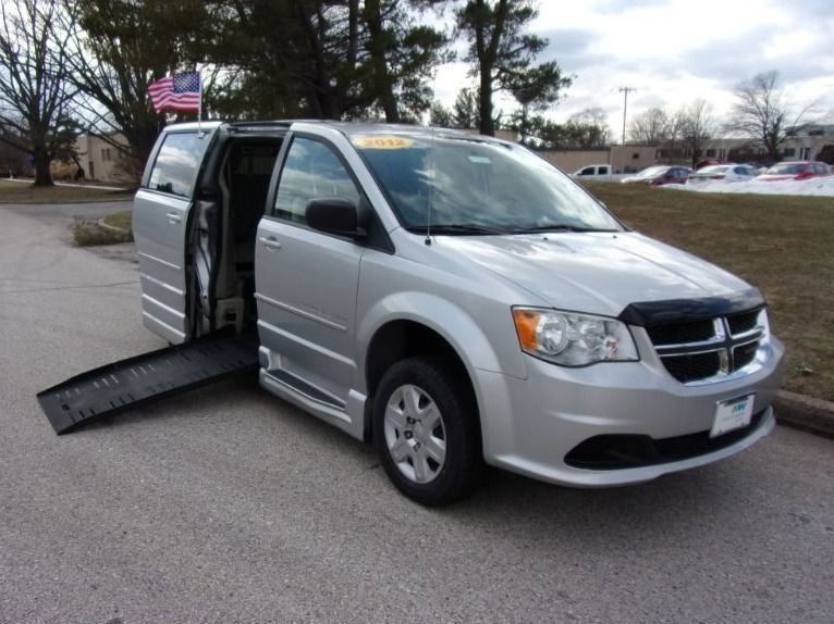 Silver Dodge Grand Caravan with Side Entry Manual  ramp