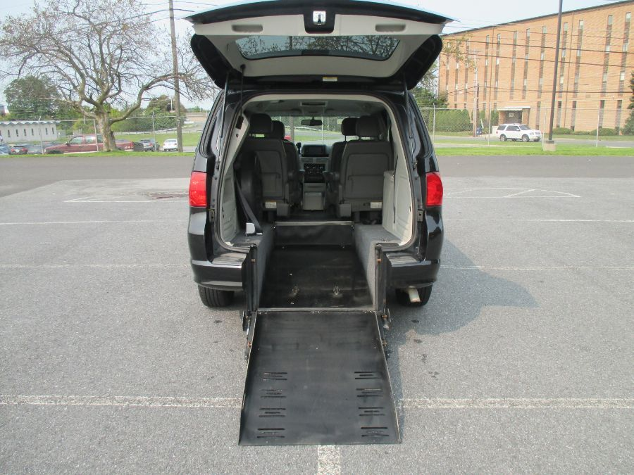 Blue Volkswagen Routan with Rear Entry Manual Fold Out ramp