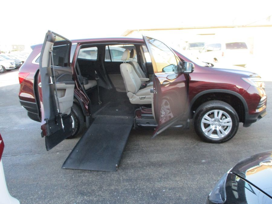 Red Honda Pilot with Side Entry Manual In Floor ramp