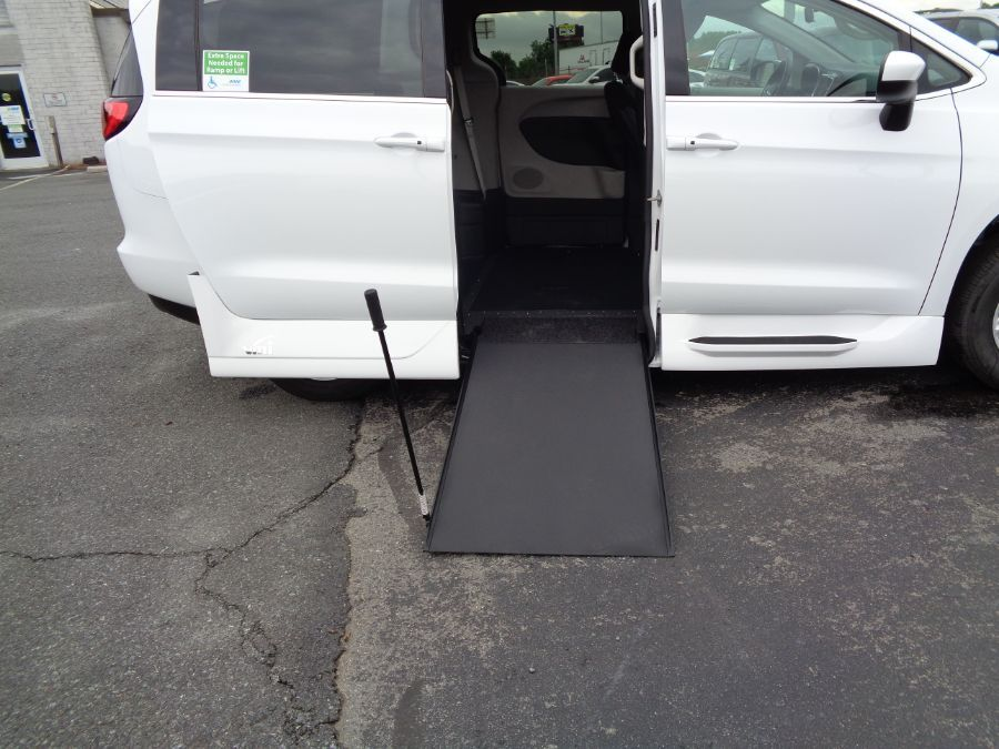 White Chrysler Voyager with Side Entry Manual In Floor ramp