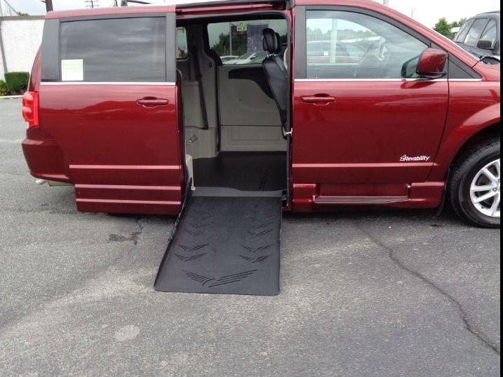Red Dodge Grand Caravan with    ramp