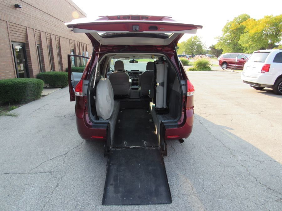 Red Toyota Sienna with Rear Entry Automatic Fold Out ramp
