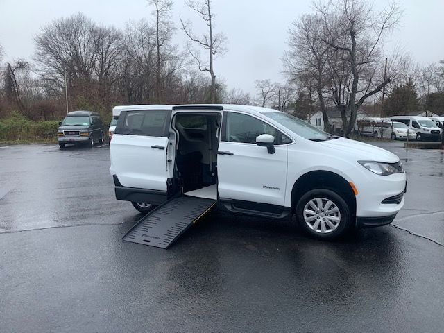 White Chrysler Voyager with Side Entry Manual Fold Out ramp