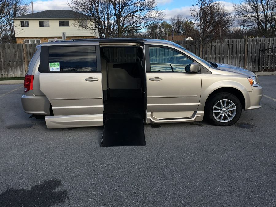 Gold Dodge Grand Caravan with Side Entry Automatic In Floor ramp