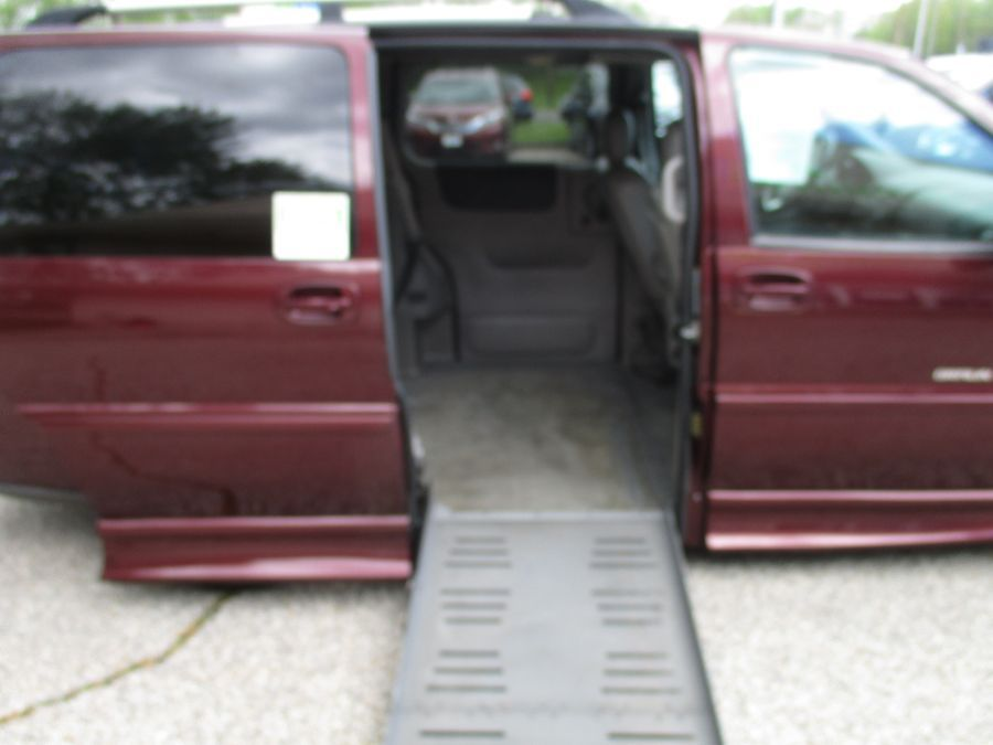 Red Chevrolet Uplander with Side Entry Automatic Fold Out ramp