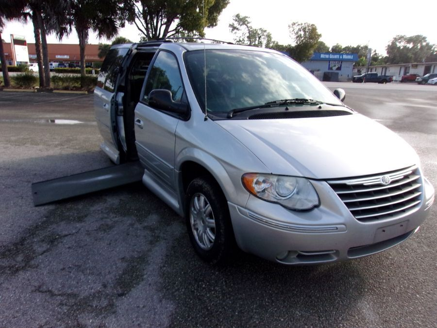 Silver Chrysler Town and Country with Side Entry Automatic In Floor ramp