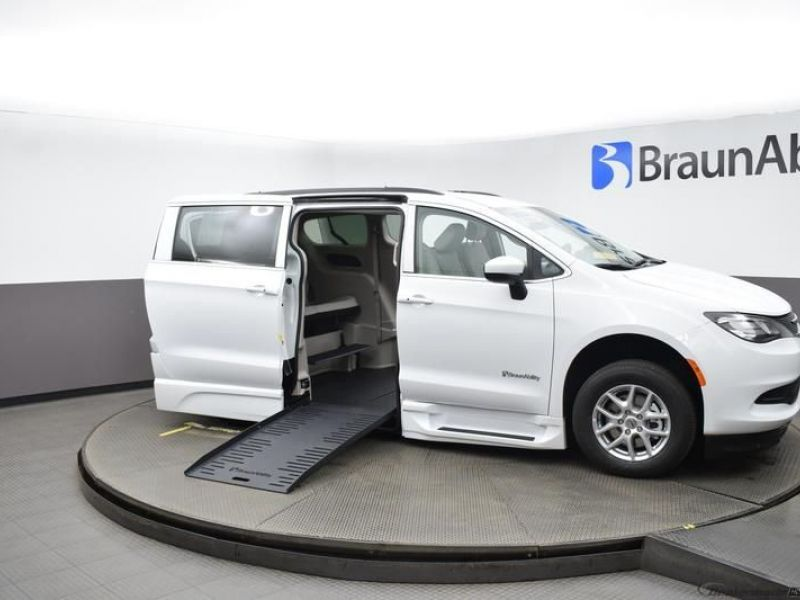 White Chrysler Voyager with Side Entry Automatic Fold Out ramp