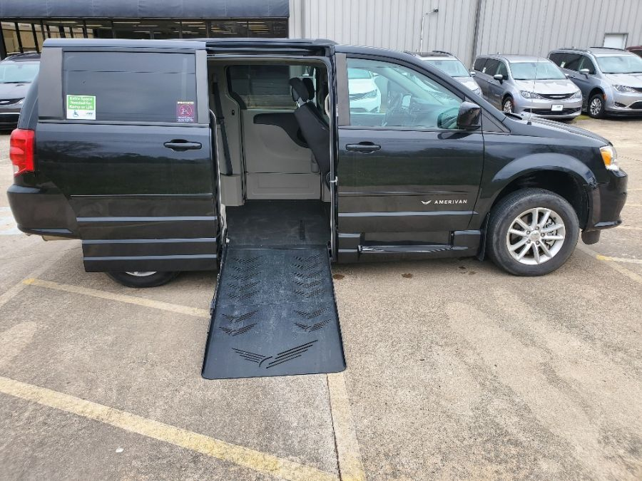 Black Dodge Grand Caravan with Side Entry Automatic  ramp
