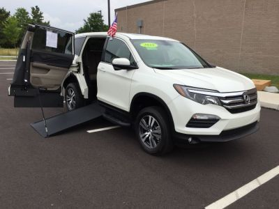 White Honda Pilot with Side Entry Manual In Floor ramp