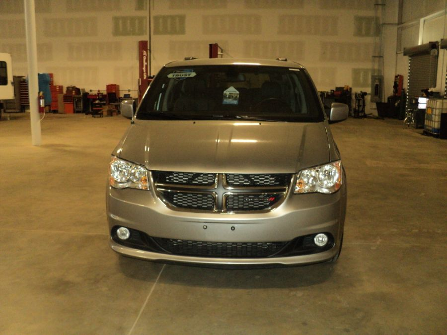 Silver Dodge Grand Caravan with Side Entry Automatic Fold Out ramp