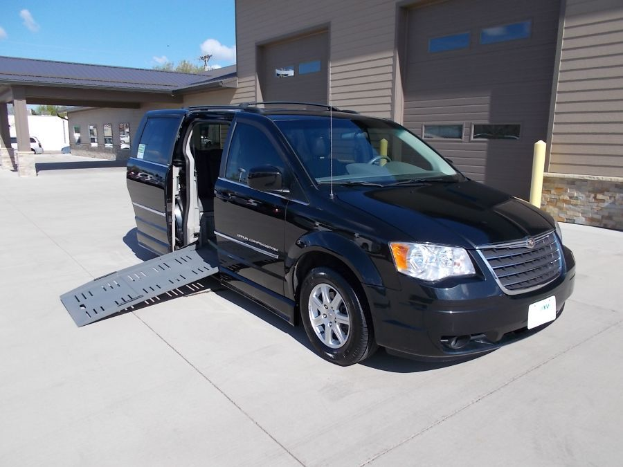 Black Chrysler Town and Country with Side Entry Manual Fold Out ramp