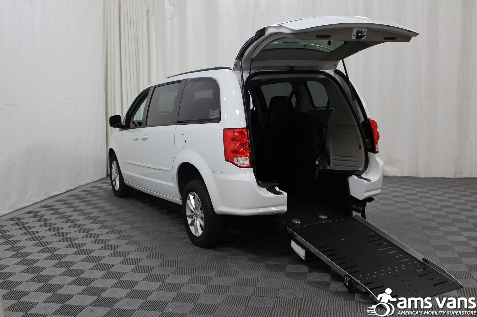 What are the advantages of AMS Wheelchair Vans?