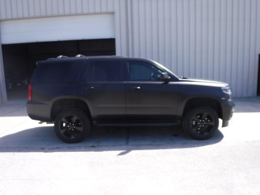 Black Chevrolet Tahoe image number 6