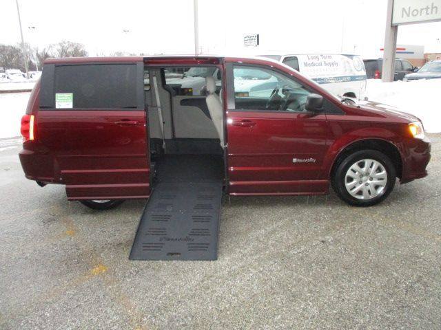 Red Dodge Grand Caravan with Side Entry Manual  ramp