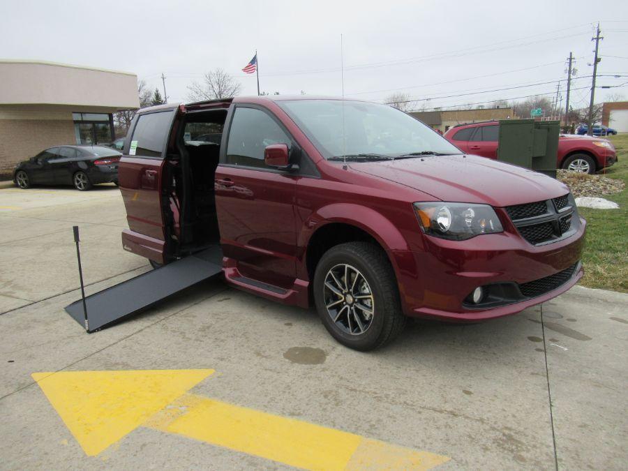 Red Dodge Grand Caravan with Side Entry Manual In Floor ramp