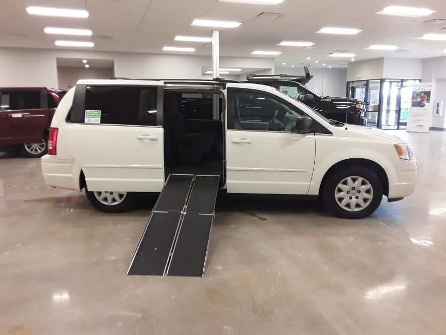White Chrysler Town and Country with Side Entry Manual  ramp